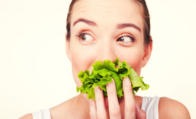 Woman with the lettuce in her mouth.