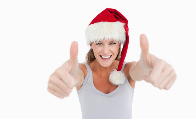 Woman with the thumbs up and a Christmas hat